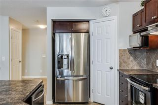 Photo 7: 81 ROYAL CREST View NW in Calgary: Royal Oak Semi Detached for sale : MLS®# C4253353
