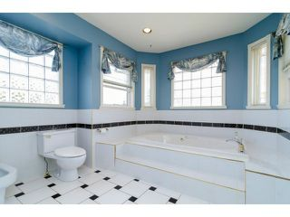 """Photo 11: 16856 57B Avenue in Surrey: Cloverdale BC House for sale in """"RICHARDSON RIDGE"""" (Cloverdale)  : MLS®# F1423543"""