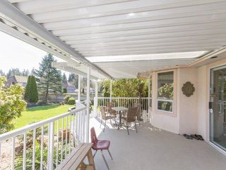 "Photo 12: 7952 144 Street in Surrey: Bear Creek Green Timbers House for sale in ""BRITISH MANOR"" : MLS®# R2049712"