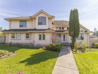 "Photo 1: 7952 144 Street in Surrey: Bear Creek Green Timbers House for sale in ""BRITISH MANOR"" : MLS®# R2049712"