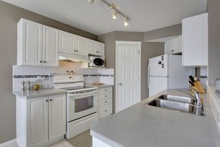 Photo 8: 77 Covewood Green NE in Calgary: House for sale : MLS®# C3650000