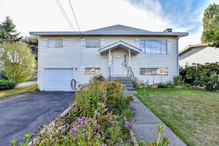 Photo 1: 8021 133A Street in Surrey: West Newton House for sale : MLS®# R2108441