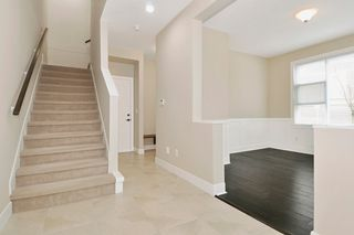 "Photo 2: 23 1299 COAST MERIDIAN Road in Coquitlam: Burke Mountain Townhouse for sale in ""THE BREEZE"" : MLS®# R2152588"