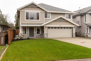 Photo 1: 2402 KITCHENER Avenue in Port Coquitlam: Woodland Acres PQ House for sale : MLS®# R2254792