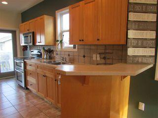 """Photo 4: 11311 88A Street in Fort St. John: Fort St. John - City NE House for sale in """"PANORAMA RIDGE"""" (Fort St. John (Zone 60))  : MLS®# R2269526"""