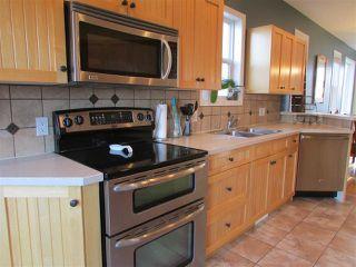 """Photo 3: 11311 88A Street in Fort St. John: Fort St. John - City NE House for sale in """"PANORAMA RIDGE"""" (Fort St. John (Zone 60))  : MLS®# R2269526"""