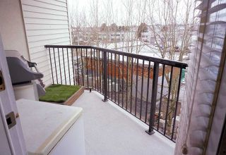 "Photo 12: 409 5765 GLOVER Road in Langley: Langley City Condo for sale in ""College Park"" : MLS®# R2348253"