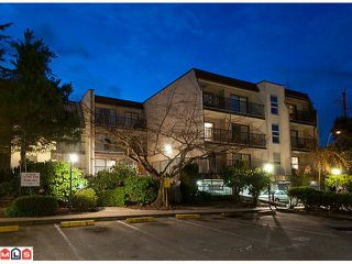 "Photo 1: 311 15238 100TH Avenue in Surrey: Guildford Condo for sale in ""CEDAR GROVE"" (North Surrey)  : MLS®# F1112639"