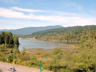 "Photo 1: 404 700 KLAHANIE Drive in Port Moody: Port Moody Centre Condo for sale in ""BOARDWALK"" : MLS®# V911604"