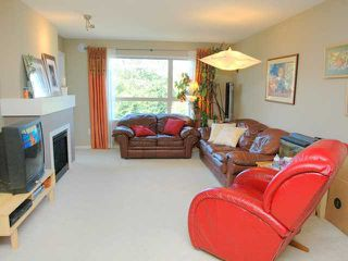 "Photo 2: 404 700 KLAHANIE Drive in Port Moody: Port Moody Centre Condo for sale in ""BOARDWALK"" : MLS®# V911604"