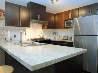 "Photo 3: 404 700 KLAHANIE Drive in Port Moody: Port Moody Centre Condo for sale in ""BOARDWALK"" : MLS®# V911604"