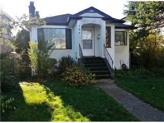Photo 1: 166 W 48TH AV in Vancouver: Oakridge VW House for sale (Vancouver West)  : MLS®# V1036594