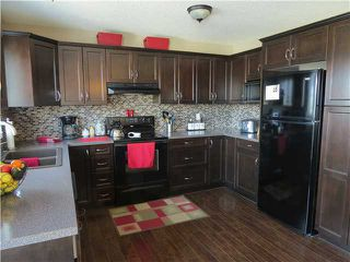 Photo 3: 6 West Copithorne Place: Cochrane Residential Detached Single Family for sale : MLS®# C3602579