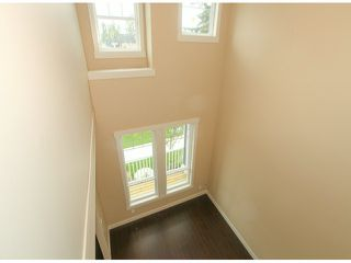 Photo 2: 5970 131ST Street in Surrey: Panorama Ridge House for sale : MLS®# F1425192