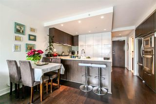 "Photo 1: 305 1680 W 4TH Avenue in Vancouver: False Creek Condo for sale in ""Mantra"" (Vancouver West)  : MLS®# R2077718"