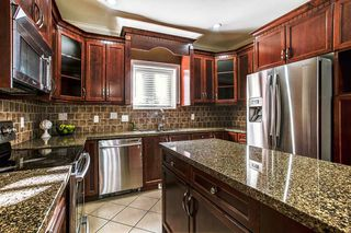 "Photo 6: 24318 102 Avenue in Maple Ridge: Albion House for sale in ""Castle Brook"" : MLS®# R2126861"