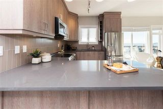 """Photo 2: 125 3528 SHEFFIELD Avenue in Coquitlam: Burke Mountain Townhouse for sale in """"WHISPER"""" : MLS®# R2137429"""