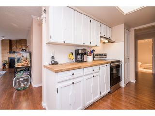 """Photo 12: 202 20420 54 Avenue in Langley: Langley City Condo for sale in """"Ridgewood Manor"""" : MLS®# R2156642"""