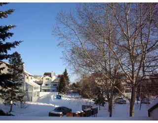 Photo 3: 247 LANCASTER Terrace in Edmonton: Zone 27 Carriage for sale : MLS®# E4180669
