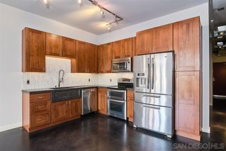 Photo 3: DOWNTOWN Condo for rent : 1 bedrooms : 777 6Th Ave #209 in San Diego