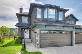 Main Photo: 63 COUGAR RIDGE Bay SW in Calgary: Cougar Ridge Semi Detached for sale : MLS®# A1019760