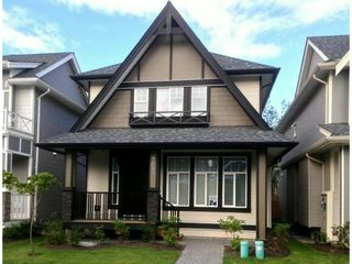 """Photo 1: 7689 211A Street in Langley: Willoughby Heights House for sale in """"YORKSON"""" : MLS®# F1326390"""