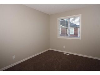 Photo 18: 199 Panatella Square NW in Calgary: Panorama Hills Townhouse for sale : MLS®# C3646555