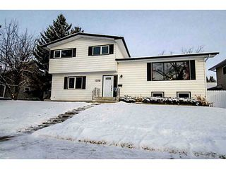 Photo 2: 1708 107 Avenue SW in Calgary: Braeside_Braesde Est Residential Detached Single Family for sale : MLS®# C3651455