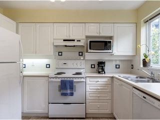 """Photo 5: 19 1561 BOOTH Avenue in Coquitlam: Maillardville Townhouse for sale in """"THE COURCELLES"""" : MLS®# V1121240"""