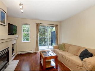 """Photo 1: 19 1561 BOOTH Avenue in Coquitlam: Maillardville Townhouse for sale in """"THE COURCELLES"""" : MLS®# V1121240"""