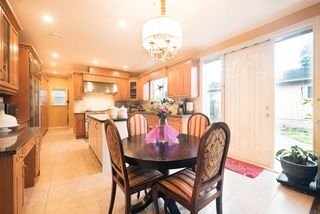 """Photo 9: 5651 EARLES Street in Vancouver: Collingwood VE House for sale in """"Colingwood"""" (Vancouver East)  : MLS®# R2023903"""