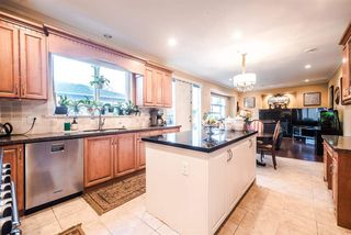 """Photo 8: 5651 EARLES Street in Vancouver: Collingwood VE House for sale in """"Colingwood"""" (Vancouver East)  : MLS®# R2023903"""