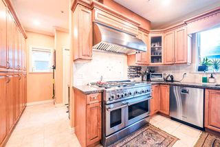 """Photo 6: 5651 EARLES Street in Vancouver: Collingwood VE House for sale in """"Colingwood"""" (Vancouver East)  : MLS®# R2023903"""