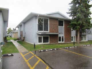 Main Photo: 3 6318 58 Avenue in Red Deer: RR Highland Green Estates Residential Condo for sale : MLS®# CA0180100