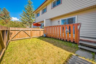 Photo 14: 110 6100 4 Avenue NE in Calgary: Marlborough Park Row/Townhouse for sale : MLS®# A1012506