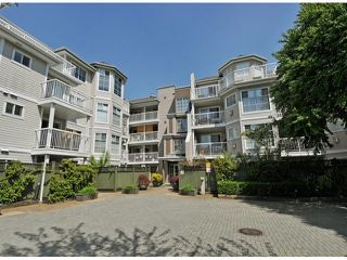 Photo 1: 311 2678 DIXON Street in Port Coquitlam: Central Pt Coquitlam Condo for sale : MLS®# V1051693