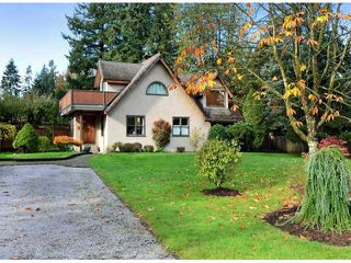 "Photo 1: 4627 198A Street in Langley: Langley City House for sale in ""MASON HEIGHTS"" : MLS®# F1425848"