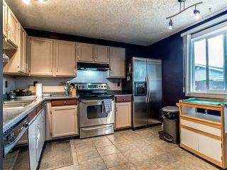 Photo 7: 27 Woodmont Green SW in Calgary: Woodbine House for sale : MLS®# C4022488