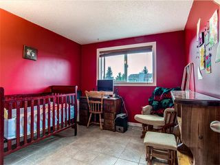 Photo 15: 27 Woodmont Green SW in Calgary: Woodbine House for sale : MLS®# C4022488