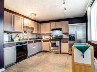 Photo 8: 27 Woodmont Green SW in Calgary: Woodbine House for sale : MLS®# C4022488