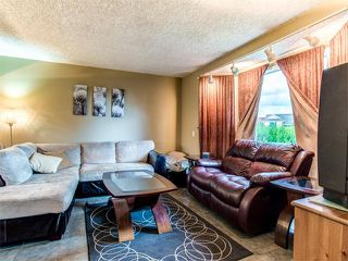 Photo 3: 27 Woodmont Green SW in Calgary: Woodbine House for sale : MLS®# C4022488