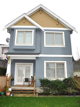 Photo 1: 1723 E 28TH Avenue in Vancouver: Victoria VE House 1/2 Duplex for sale (Vancouver East)  : MLS®# R2046846