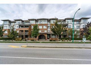 "Photo 1: 102 18755 68 Avenue in Surrey: Clayton Condo for sale in ""COMPASS"" (Cloverdale)  : MLS®# R2112089"