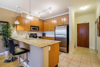 Photo 4: 216 15385 101A AVENUE in Surrey: Guildford Condo for sale (North Surrey)  : MLS®# R2253513