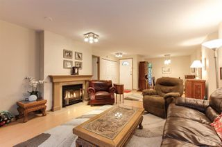 Photo 4: 205 2733 ATLIN Place in Coquitlam: Coquitlam East Condo for sale : MLS®# R2350938