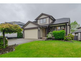 "Photo 1: 18276 69 Avenue in Surrey: Cloverdale BC House for sale in ""Cloverwoods"" (Cloverdale)  : MLS®# R2369738"