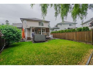"Photo 19: 18276 69 Avenue in Surrey: Cloverdale BC House for sale in ""Cloverwoods"" (Cloverdale)  : MLS®# R2369738"