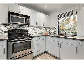 Photo 2: 1847 W 14TH Avenue in Vancouver: Kitsilano House 1/2 Duplex for sale (Vancouver West)  : MLS®# V1035652