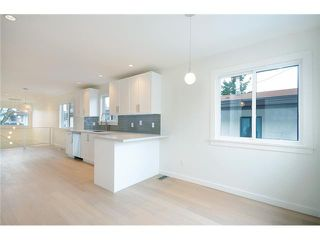 "Photo 9: 985 E 38TH Avenue in Vancouver: Fraser VE House for sale in ""FRASER"" (Vancouver East)  : MLS®# V1048813"