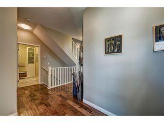 Photo 3: 23 AUTUMN Gardens SE in Calgary: Auburn Bay House for sale : MLS®# C4017577